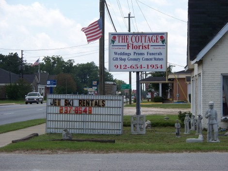 """The other side of the sign says """"bus for sale"""""""